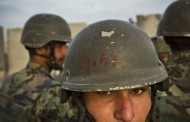 Afghan soldier held for NATO shooting escapes